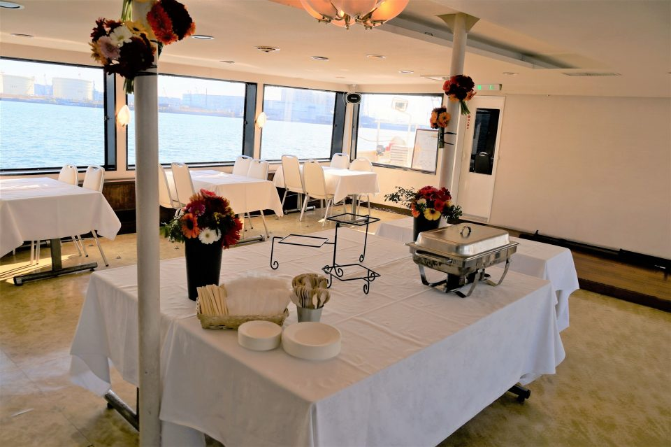 Inside the boat * decorated with a table cloth and flowers