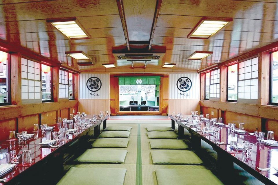 Inside Ebiya-maru with Japanese cushions and tableware